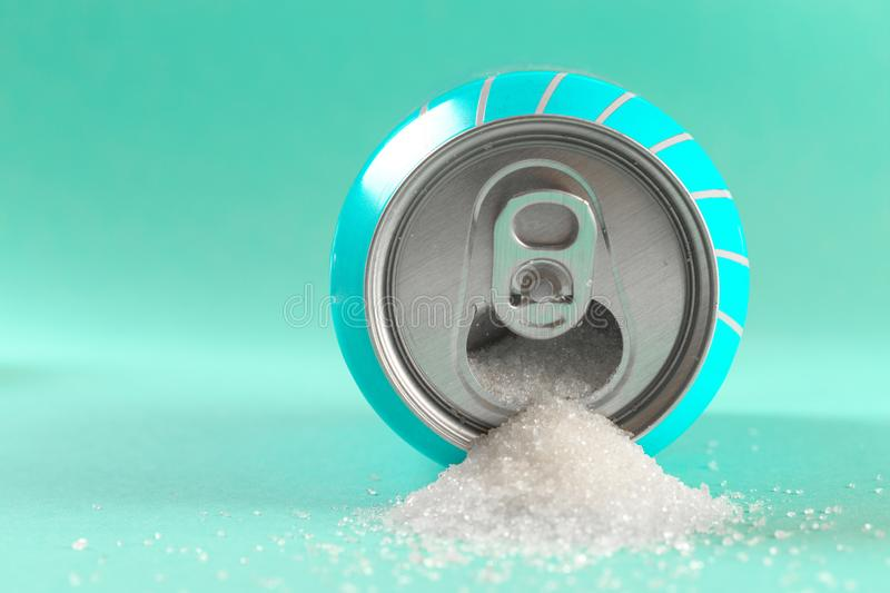 Refresh drink can pouring sugar stream in sweet and calories content of soda and energy drinks concept in unhealthy nutrition and. Diet concept royalty free stock image