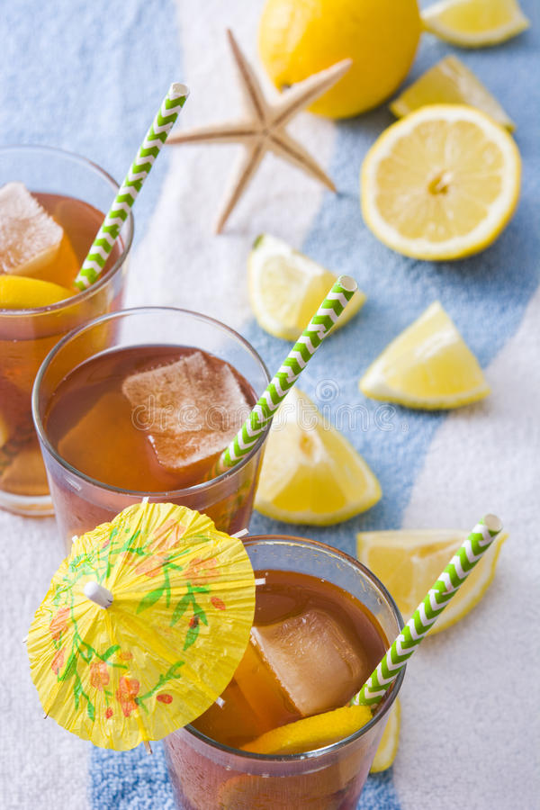 Refresh Ice tea with lemon on summer towel royalty free stock photos