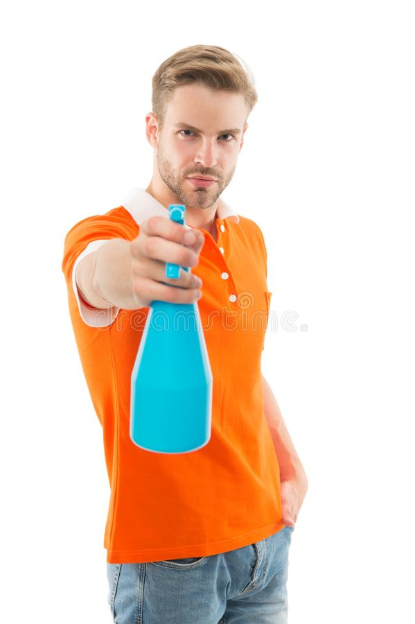 Refresh right now. Man hold mist sprayer like weapon aiming you. On his target. Refreshing shot. Man handsome guy. Offering refreshing spray. Cleaning day stock photo