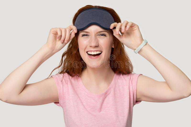 Refreshed after enough sleeping woman in eye mask pose indoors stock image