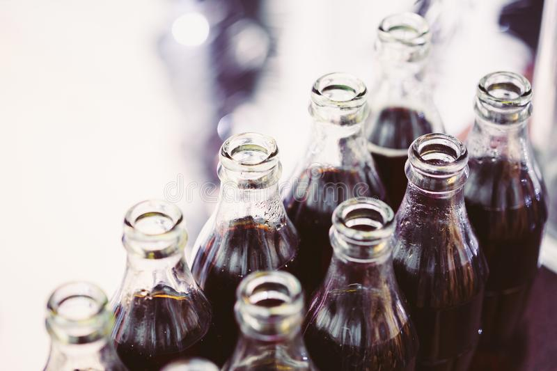 Refreshing Brown Soda in bottles in Candy Bar On Table. Delicious sweet buffet royalty free stock image