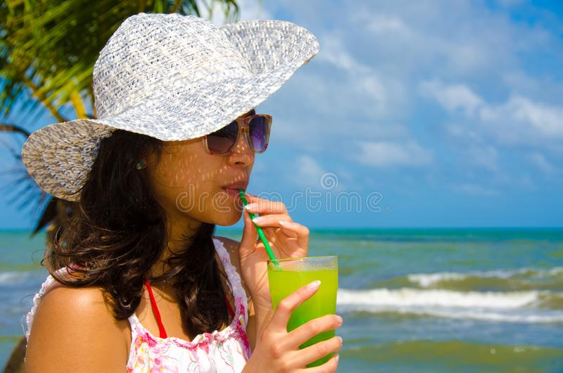 Refreshing Cocktail at beach in Belize - recreation in tropical destination for vacation - paradise coast stock photos