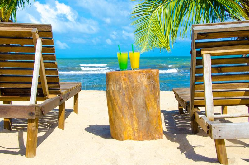 Refreshing Cocktail at beach in Belize - recreation in tropical destination for vacation - paradise coast royalty free stock photography