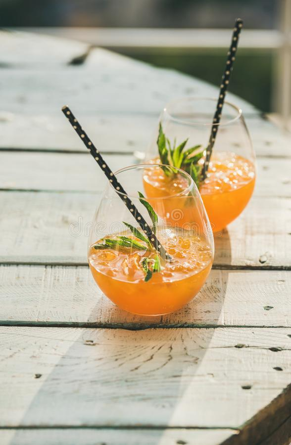 Refreshing cold alcoholic summer citrus cocktail with orange, copy space royalty free stock photography