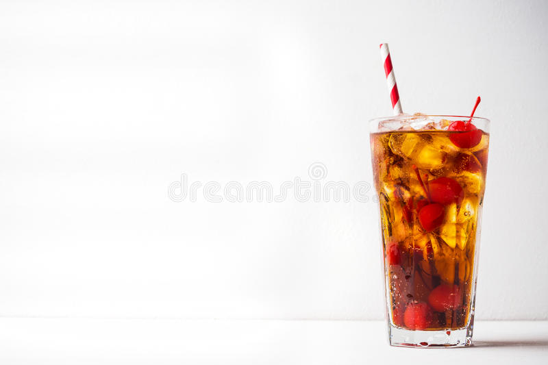 Refreshing cold cherry cola. On the wooden background stock image