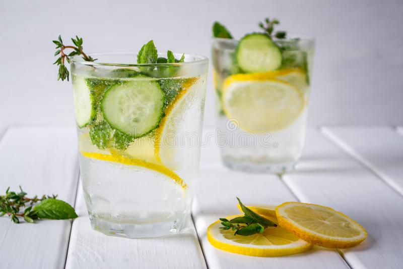 Refreshing cucumber cocktail, lemonade, detox water in a glasses on a white background. royalty free stock images