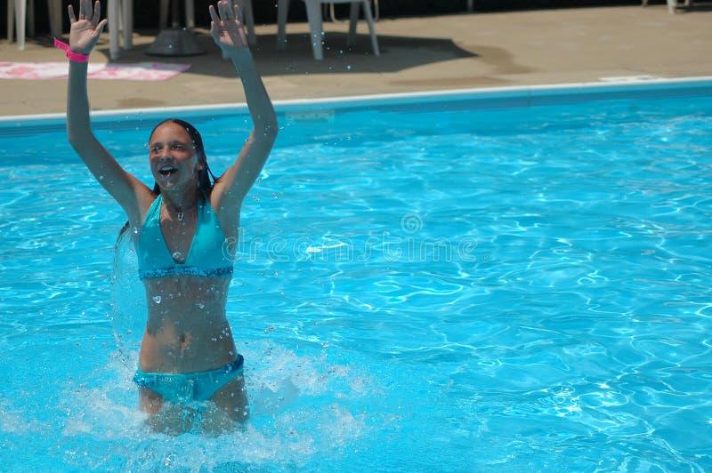Refreshing dip in pool royalty free stock photos