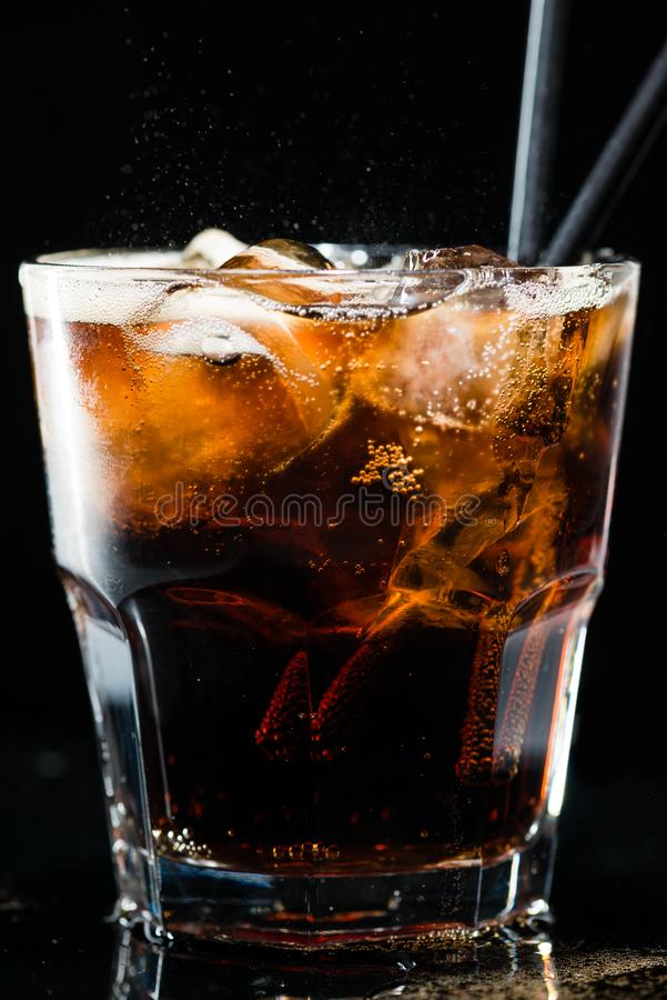 Refreshing drink of cola and ice in a glass royalty free stock photos