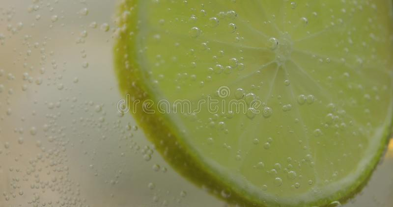 A refreshing drink in a glass with ice, and lime. Soda tonic fizzy water royalty free stock images