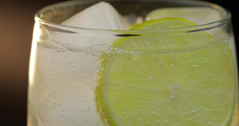 A refreshing drink in a glass with ice, and lime. Soda tonic fizzy water stock photos
