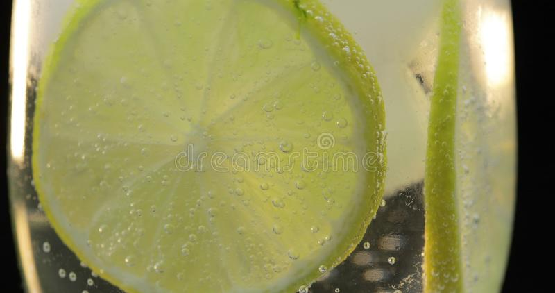 A refreshing drink in a glass with ice, and lime. Soda tonic fizzy water royalty free stock photo