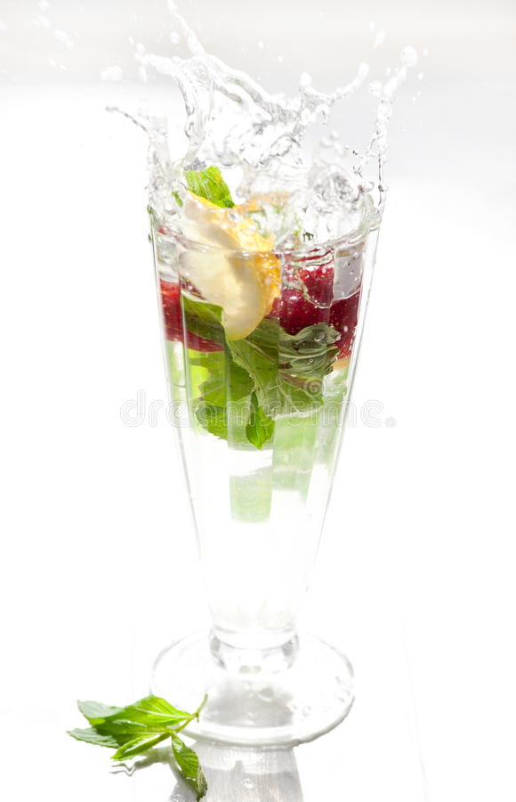 Refreshing drink with splashes royalty free stock photo