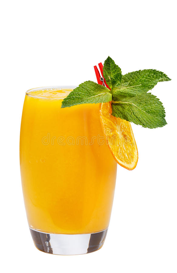 Refreshing fruit cocktail. Refreshing drink with mango pulp, decorated with orange slice and mint. royalty free stock images