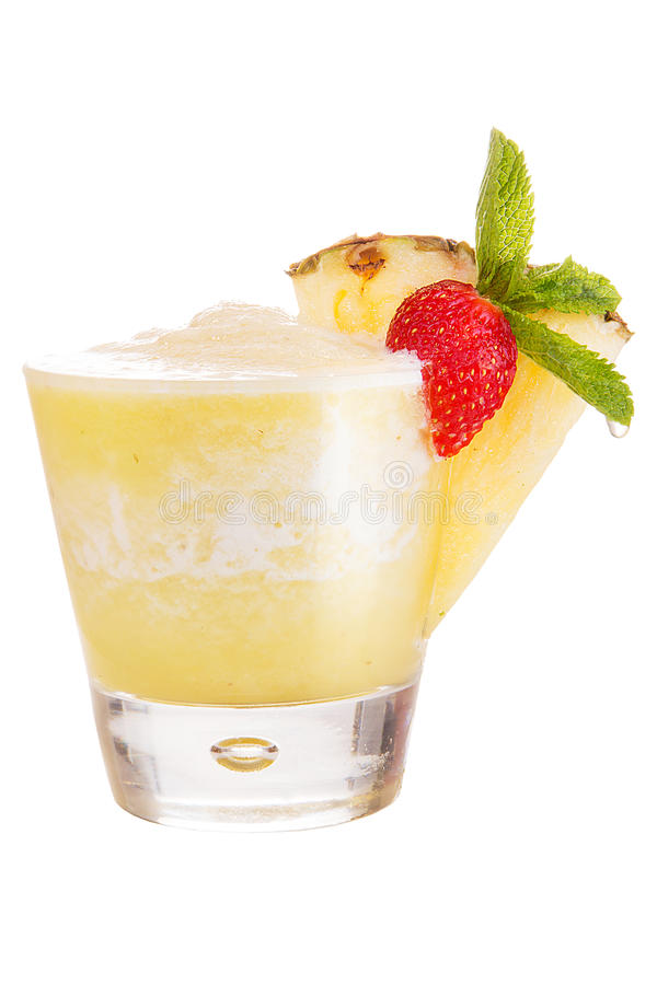 A refreshing fruit cocktail. Refreshing pineapple drink, decorated with a slice of pineapple and mint stock images