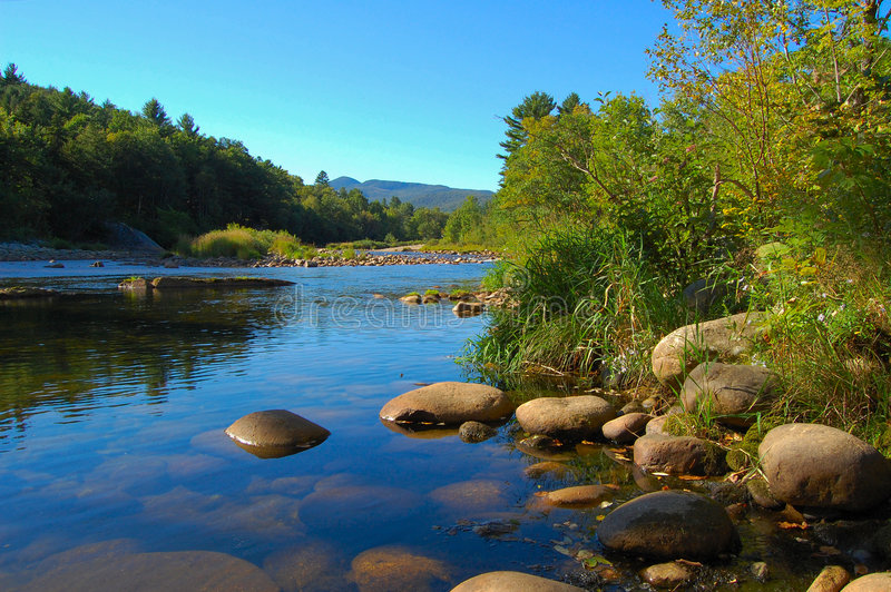 Refreshing mountain stream stock photography