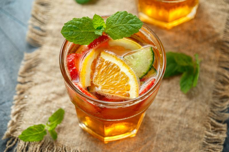 Refreshing Pimms Cocktail with Fruit and vegetables stock images