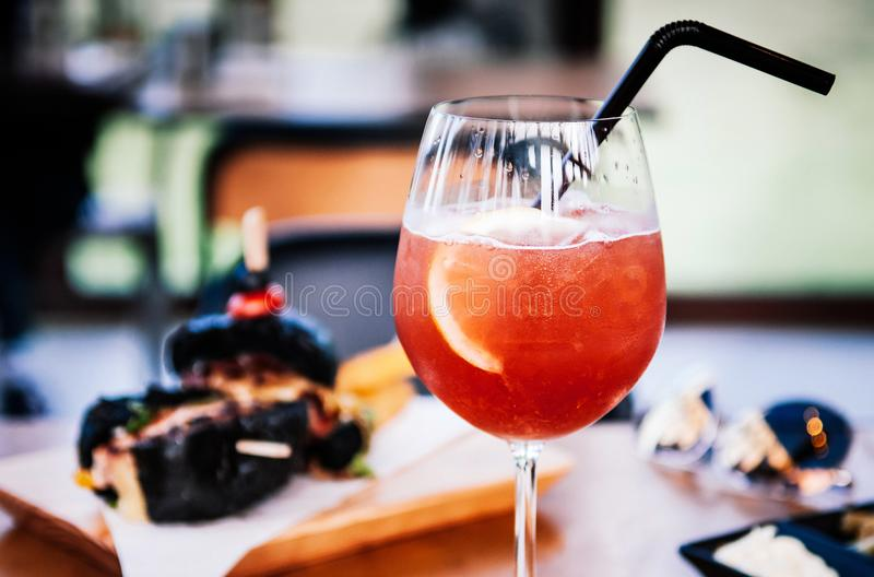 Refreshing red citrus cocktail punch with fresh lemon slice in w stock photo
