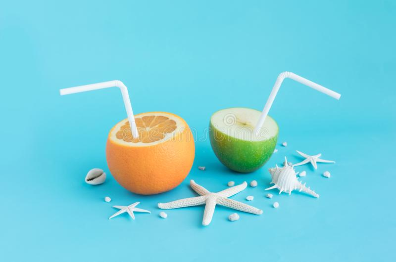 Refreshing in summer concept with orange juice and apple stock photos