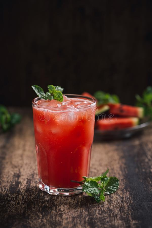 Refreshing summer watermelon juice in glasses with slices of watermelon.  royalty free stock photography