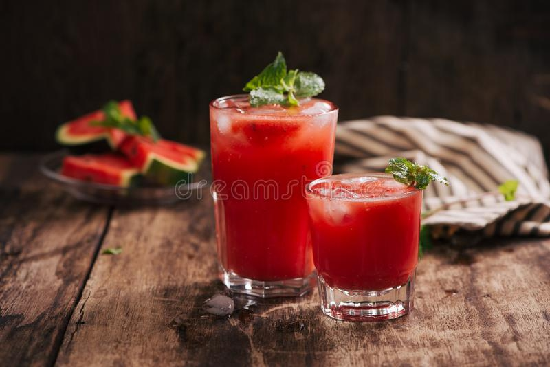 Refreshing summer watermelon juice in glasses with slices of watermelon stock photo