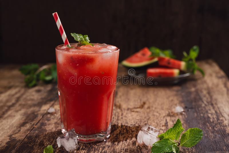 Refreshing summer watermelon juice in glasses with slices of watermelon.  stock images