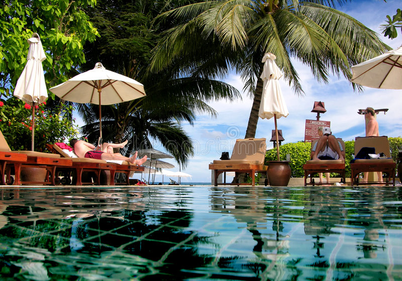 Refreshing Swimming Pool. People resting in a resort swimming pool stock photos