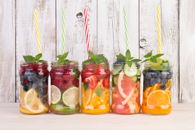 Refreshing water with fruits and mint royalty free stock photography