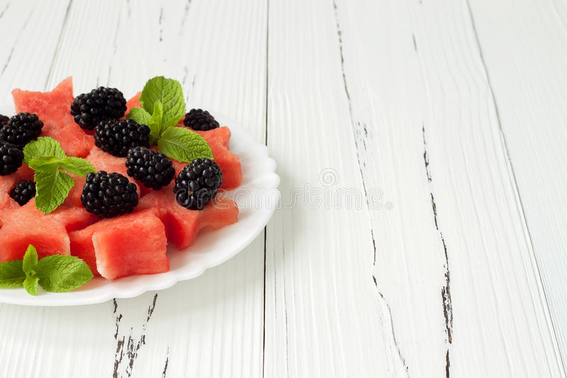 Refreshing watermelon salad with blackberries and mint. Fresh star shaped watermelon. royalty free stock photo