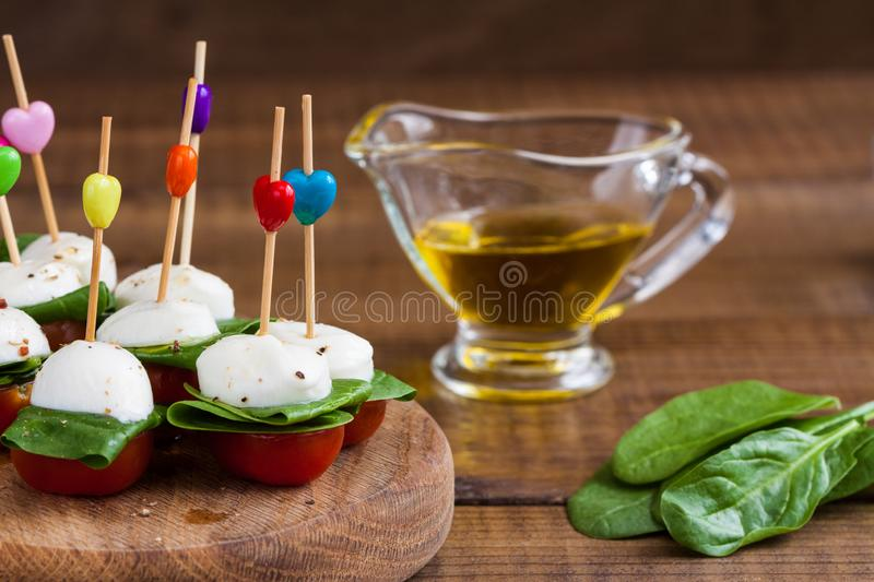 Refreshment with cherry tomatoes and mozzarella stock photography