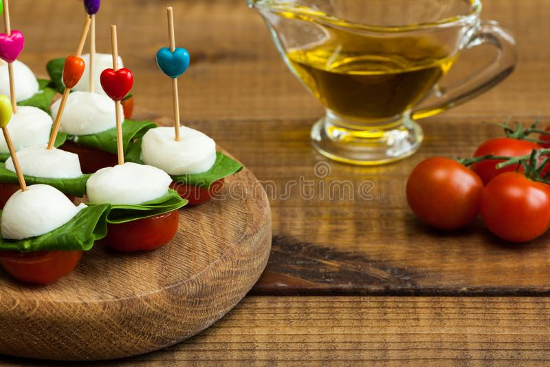 Refreshment with cherry tomatoes and mozzarella royalty free stock images