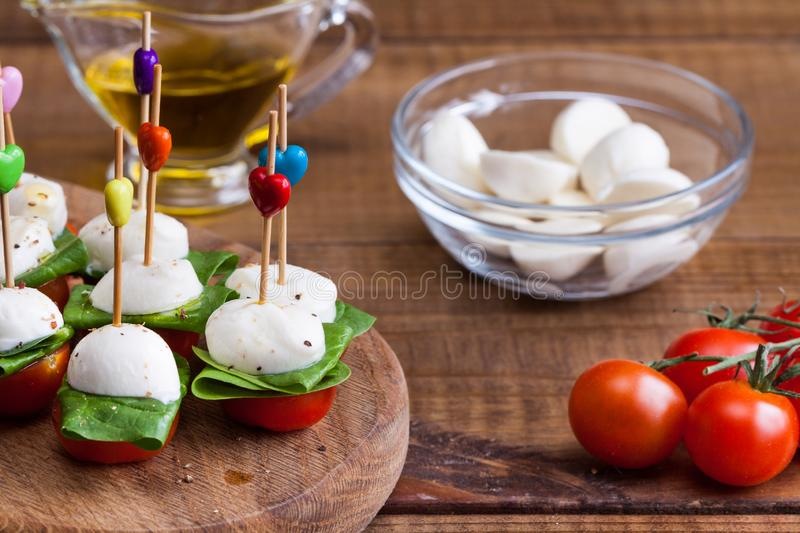 Refreshment with cherry tomatoes and mozzarella stock images