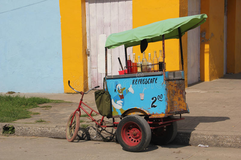 Refreshment drinks vendor in Trinidad, Cuba. A bike of a refreshment drinks vendor in Trinidad, Cuba. Trinidad is a town in the province of Sancti Spíritus royalty free stock image