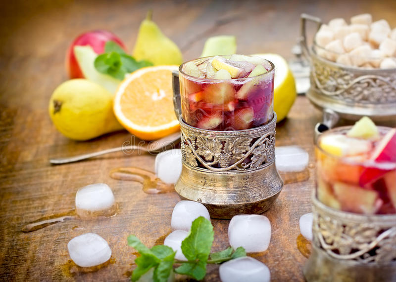 Refreshment in hot summer days - cold sangria. On table royalty free stock photo