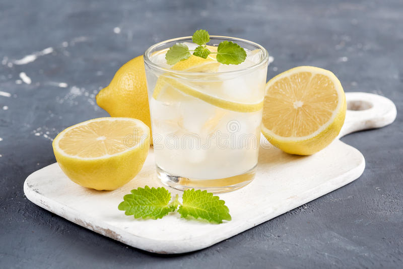 Refreshment Summer drink. Traditional lemonade with lemon mint and ice royalty free stock images