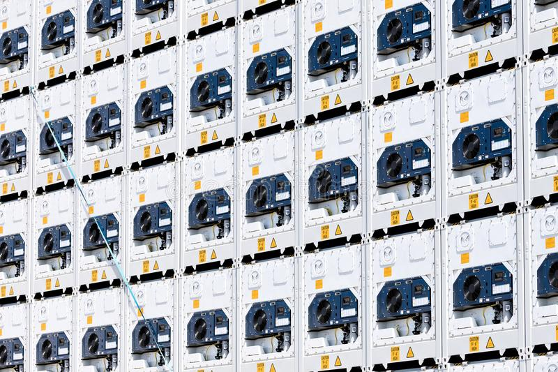 Refrigerated containers. Intermodal refrigerated containers stacked in harbor royalty free stock photos