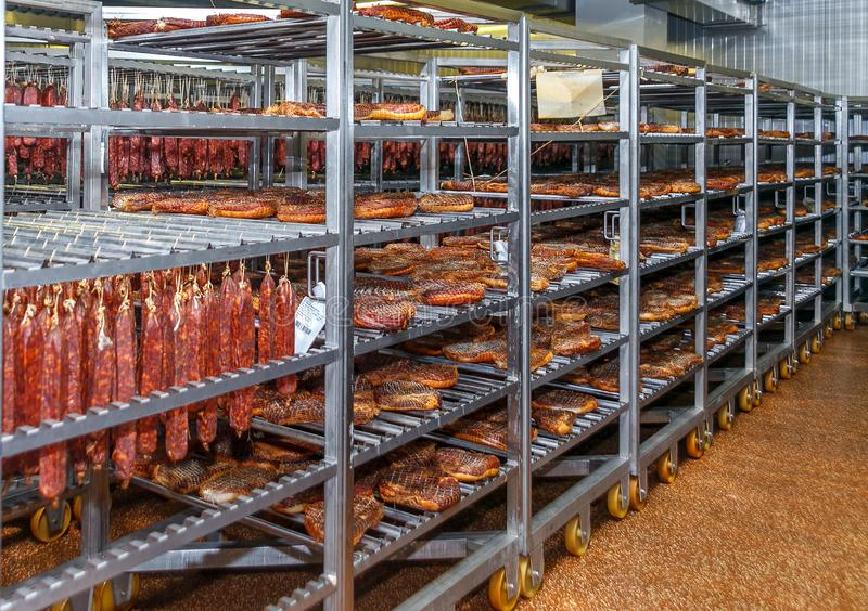 Refrigerated warehouse for storing meat and sausage products stock images