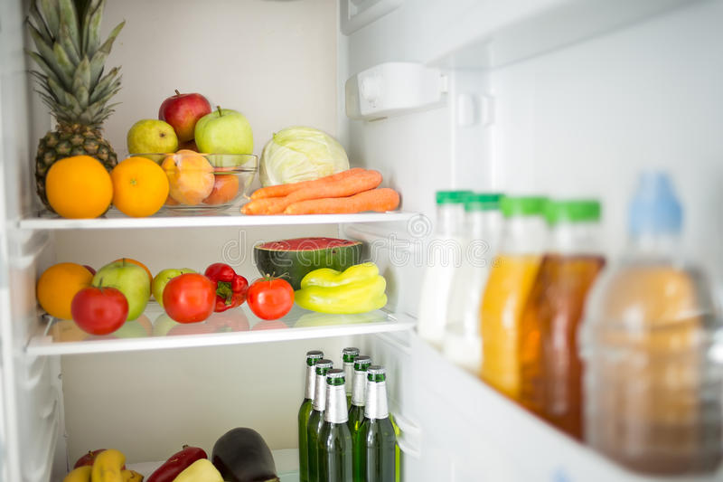 Refrigerator with fruit and vegetables stock photos