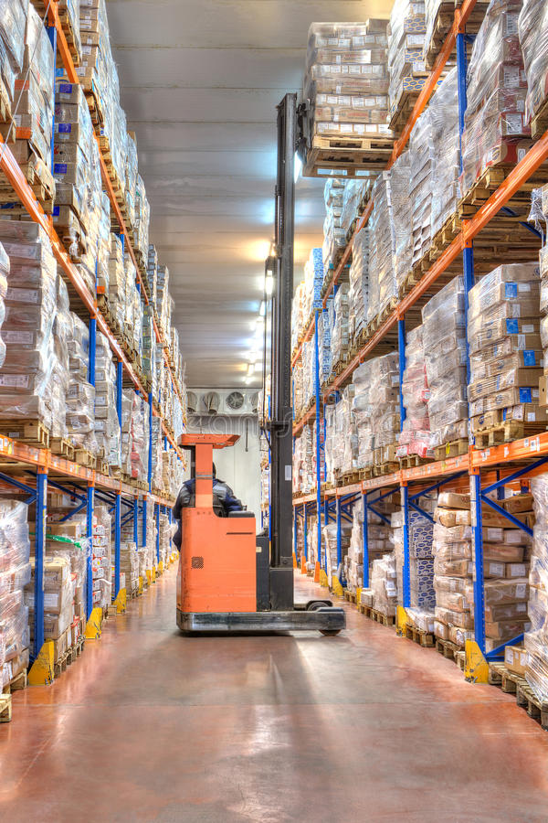 Refrigerator, huge warehouse with a frozen meat. royalty free stock image