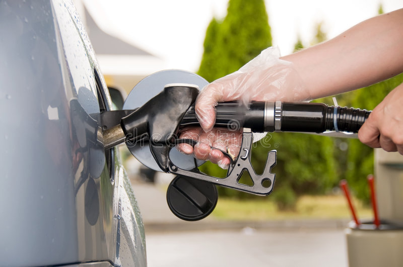Refuel. Filling up a car with fuel royalty free stock photos