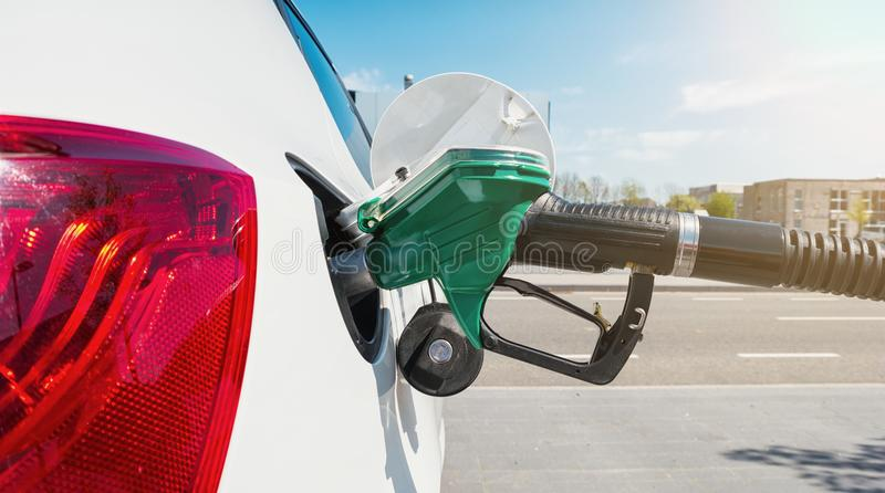 Fill the gas tank eco car self service royalty free stock photography
