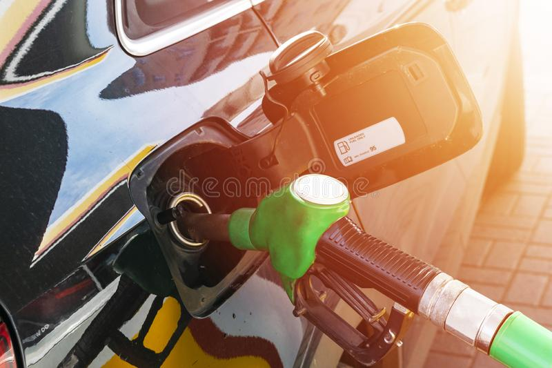 Refueling the car at a gas station fuel pump. Man driver hand refilling and pumping gasoline oil the car with fuel at he refuel st stock photos