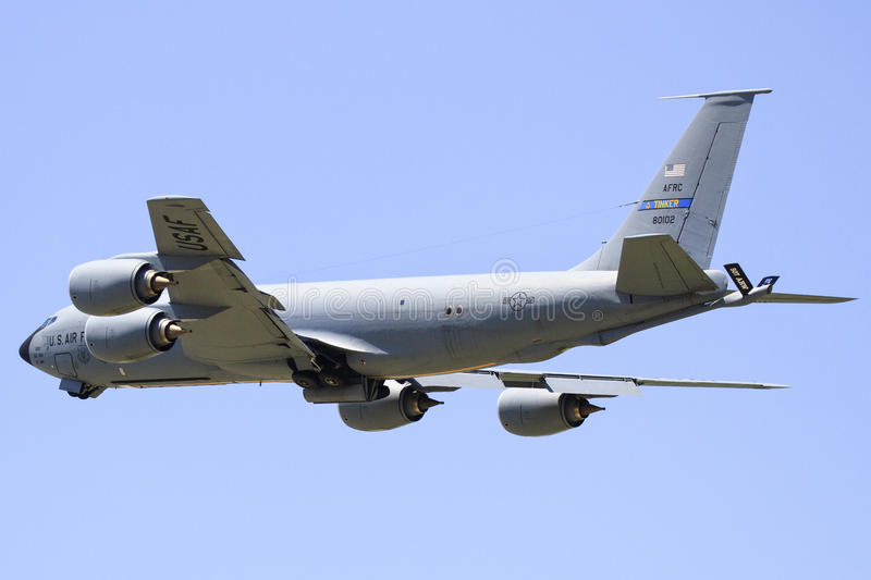 Refueling plane flying high. Air force plane flaying high preparing to refuel fighter pilots stock photo