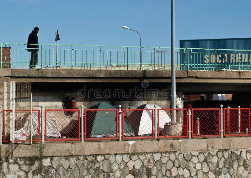 Refugee Calais camp under bridge. stock images