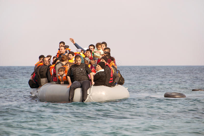 Refugees arriving in Greece in dinghy boat from Turkey. LESVOS, GREECE February 02, 2016: Refugees arriving in Greece in dinghy boat from Turkey. These Syrian stock photo