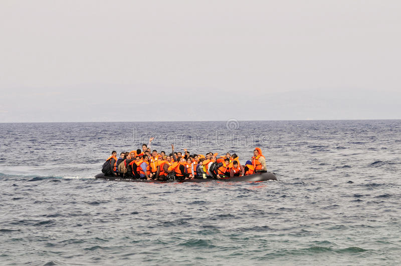 Refugees arriving in Greece in dingy boat from Turkey royalty free stock image