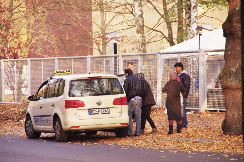 Refugees in Berlin, stopped a taxi, Spandau, October 29, 2015 royalty free stock image