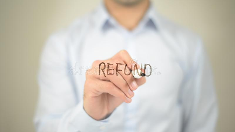 Refund, Man writing on transparent screen. High quality stock photos