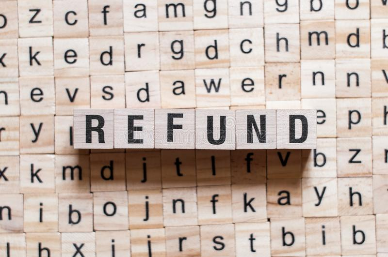 Refund word concept. On cubes royalty free stock photos