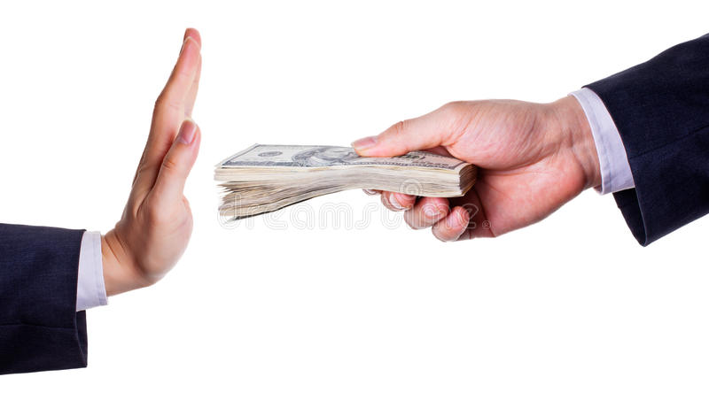 Refuse bribe. The hand at left is the sign for no/refuse and the hand with money at right means bribe - concept for refuse bribe royalty free stock images