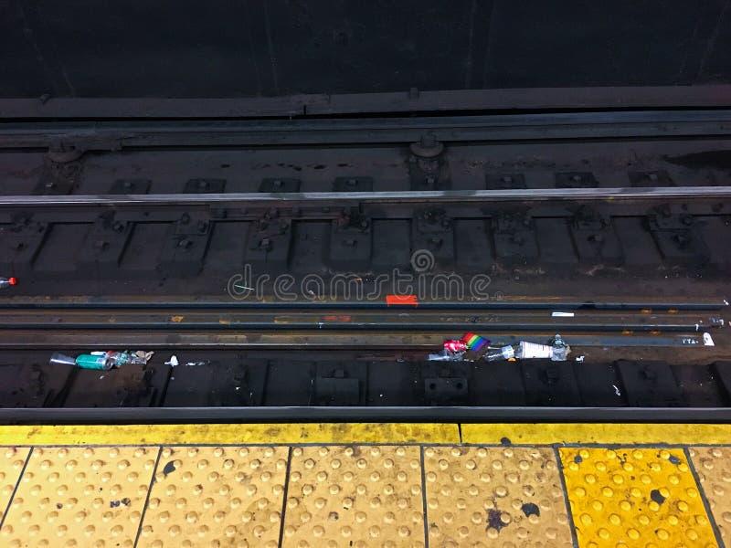NYC Subway trash on tracks royalty free stock photography